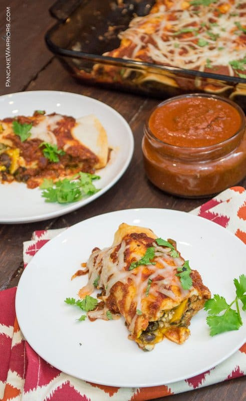 Easy pumpkin black bean enchiladas with easy, homemade enchilada sauce! Gluten free, ready in about 30 minutes, these enchiladas are sure to please a crowd! The perfect fall meal!