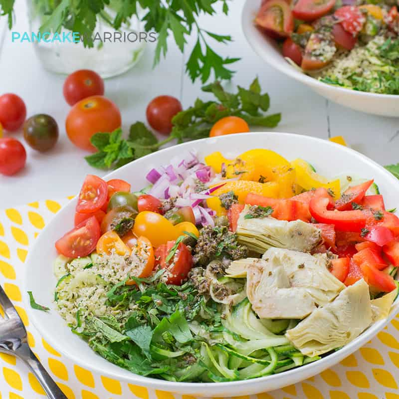 This Greek Zoodle Bowl recipe is a simple, easy summer meal that is ready in minutes, full of flavor and packed with veggies! Vegan, paleo, gluten free, whole30, grain free and delicious! | www.pancakewarriors.com